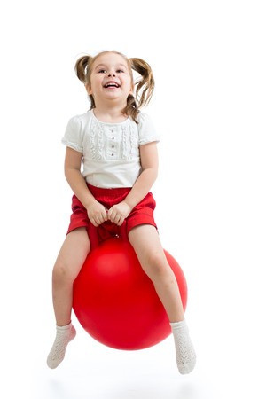 happy child jumping on bouncing ball  Isolated on white  photo