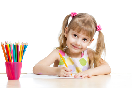 child girl drawing with colourful pencils photo