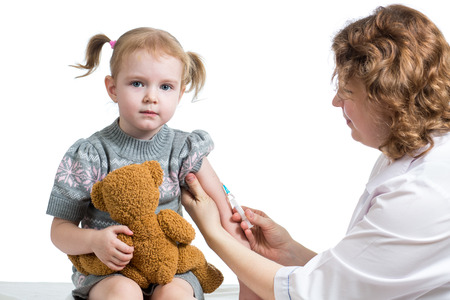 vaccinating: doctor vaccinating kid