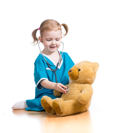 child playing doctor with toy photo