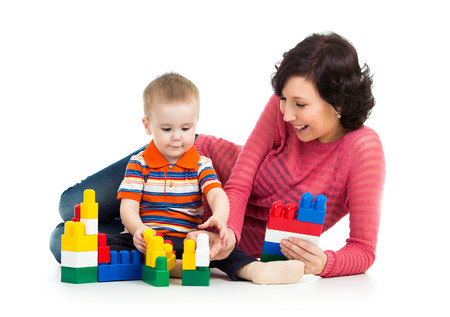 kid boy playing toys together with mother Stock Photo - 22847358