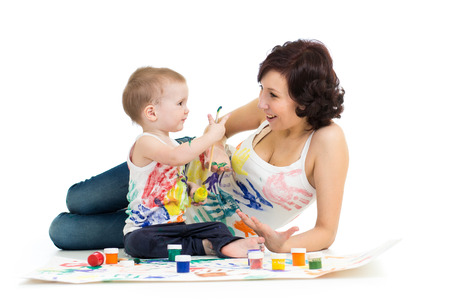 mother wih kid boy drawing and painting together Stock Photo - 22847360