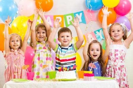 kids birthday party: happy kids celebrating birthday holiday