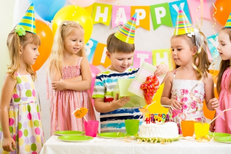 happy kids celebrating birthday holiday photo