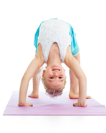 kid girl on yoga Stock Photo