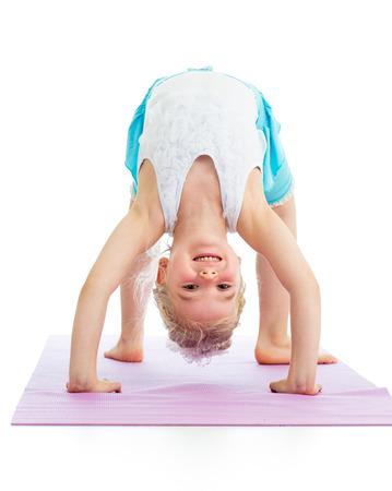 kid girl on yoga Фото со стока
