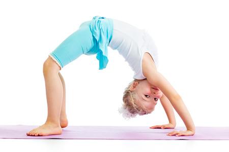 foot bridge: kid girl doing gymnastics Stock Photo