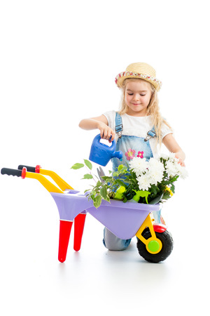 watering pot: gardener kid watering tree