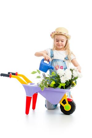 potting: gardener kid watering tree