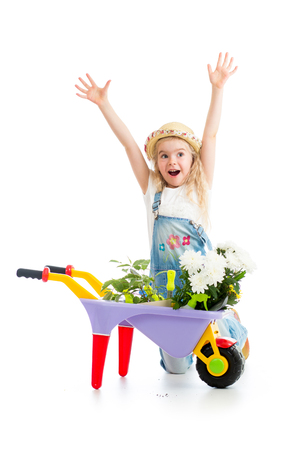 child girl with potted flowers and gardening equipment isolated photo