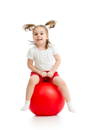happy kid girl jumping on bouncing ball photo