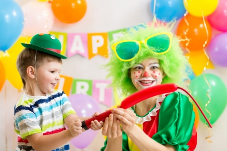 happy kid boy and clown on birthday party Stock Photo - 23108673