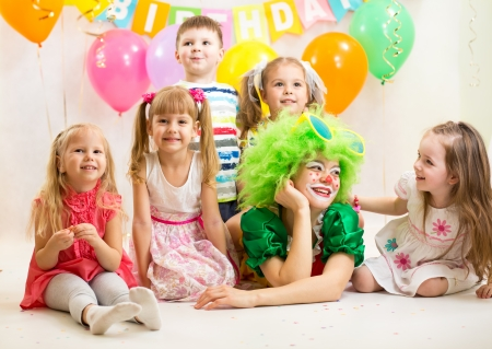 jolly kids group and clown on birthday party photo