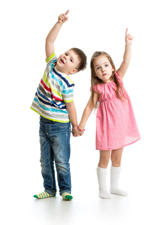 kids boy and girl showing something up photo
