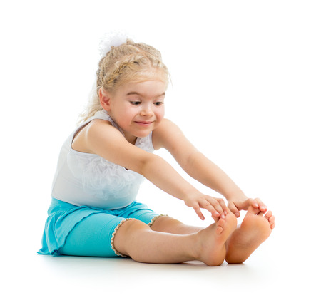 stretches: child girl doing fitness exercises