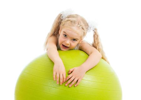 Child girl with  gymnastic ball isolated photo