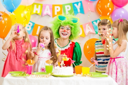 children and clown at birthday party photo