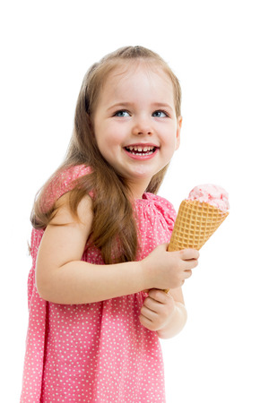 funny kid girl eating ice cream isolated photo