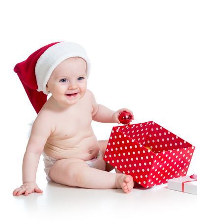 baby girl with gift box isolated on white photo