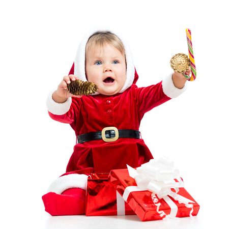 happy baby in Santa Claus clothes photo