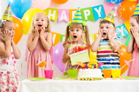 birthday party kids: group of kids at birthday party Stock Photo