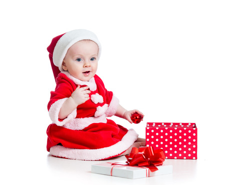 Santa Claus baby girl with gift box isolated on white background photo