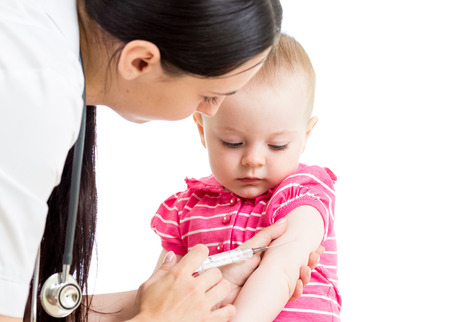 vaccinations: doctor injecting baby isolated