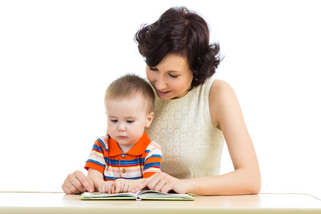 mother reading a book to her kid Stock Photo - 23713190