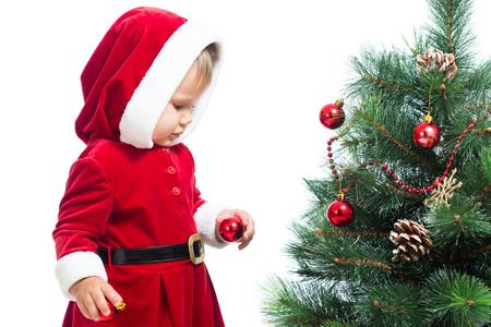 baby girl decorating Christmas tree photo