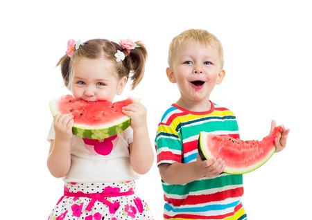 kids boy and girl eat watermelon isolated on white photo