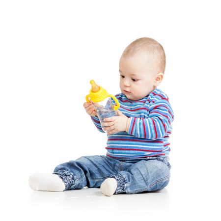 baby child drinking from bottle photo