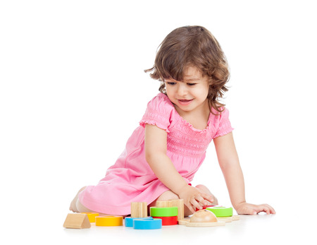 constructors: kid girl playing with block toys Stock Photo