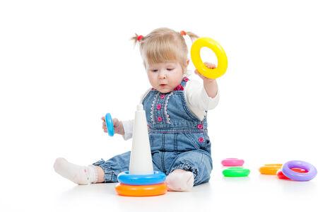 kid girl playing pyramid toy photo