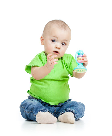 baby playing with musical toys isolated on white background photo