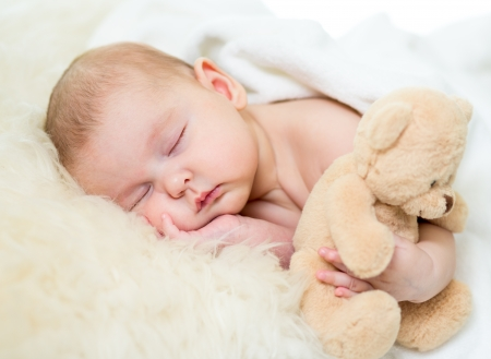 teddy: infant baby sleeping with plush toy