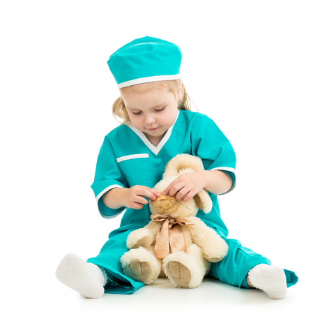 doctor s smock: doctor kid playing and curing toy isolated on white Stock Photo