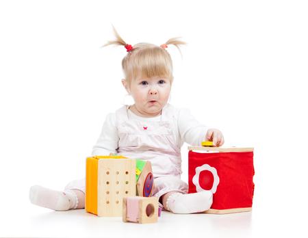kid girl playing toy blocks  isolated on white background photo