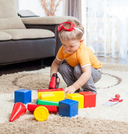 Child playing with building blocks at home Stock Photo - 23956323
