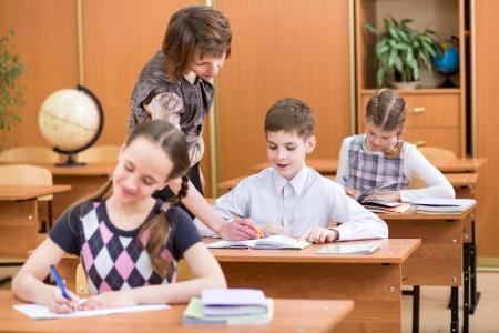 book reviews: Schoolchildren work at lesson Stock Photo