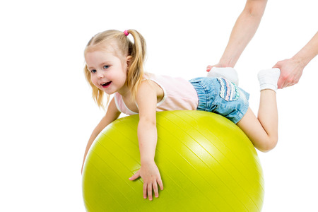balls kids: mother doing gymnastics with kid on fitness ball Stock Photo
