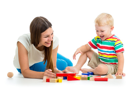 block: kid and mother play toys together Stock Photo