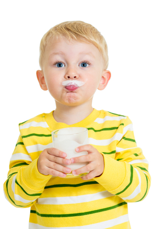 Funny kid drinking milk from glass Stock Photo - 24134915