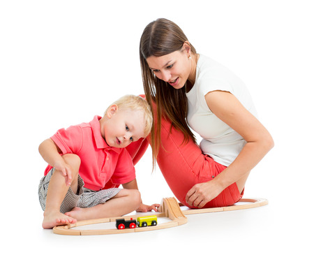 child boy and his mother play with block toy photo