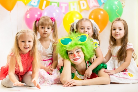 jolly children and clown on birthday party photo