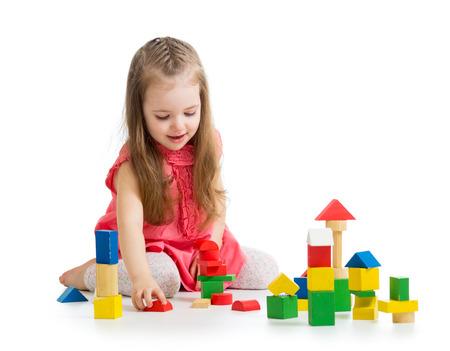 kindergarten toys: kid girl playing with block toys Stock Photo