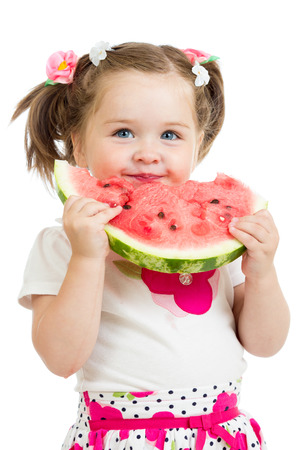child girl eating watermelon isolated on white photo