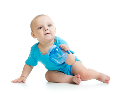 baby drinking from bottle photo