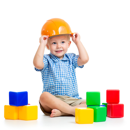 child playing with building blocks toy photo