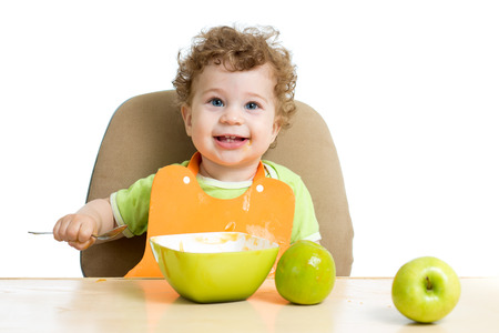 feed up: baby eating by himself