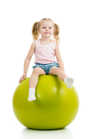 child ball: Child having fun with  gymnastic ball isolated